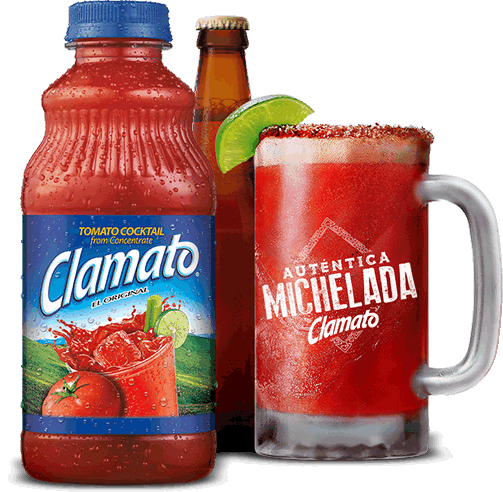 Clamato bottle, beer bottle, and authentic Michelada overlooking a city